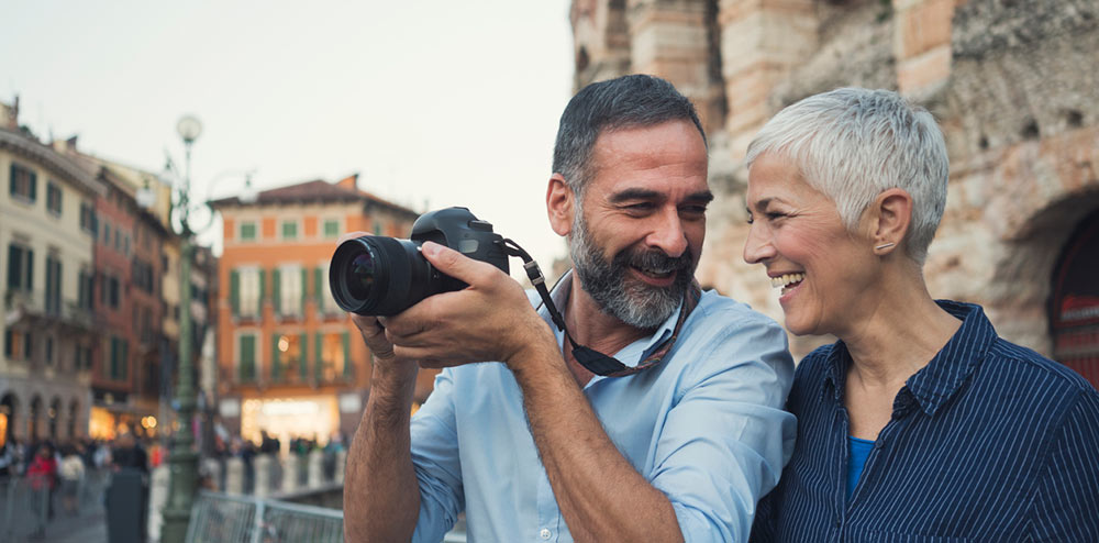 active adult senior couple traveling in Italy