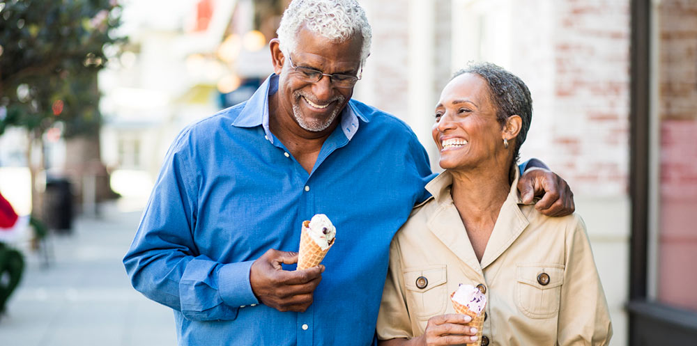 african american senior couple eating ice cream