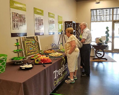 couple at Treplus table at Columbus downsizing event