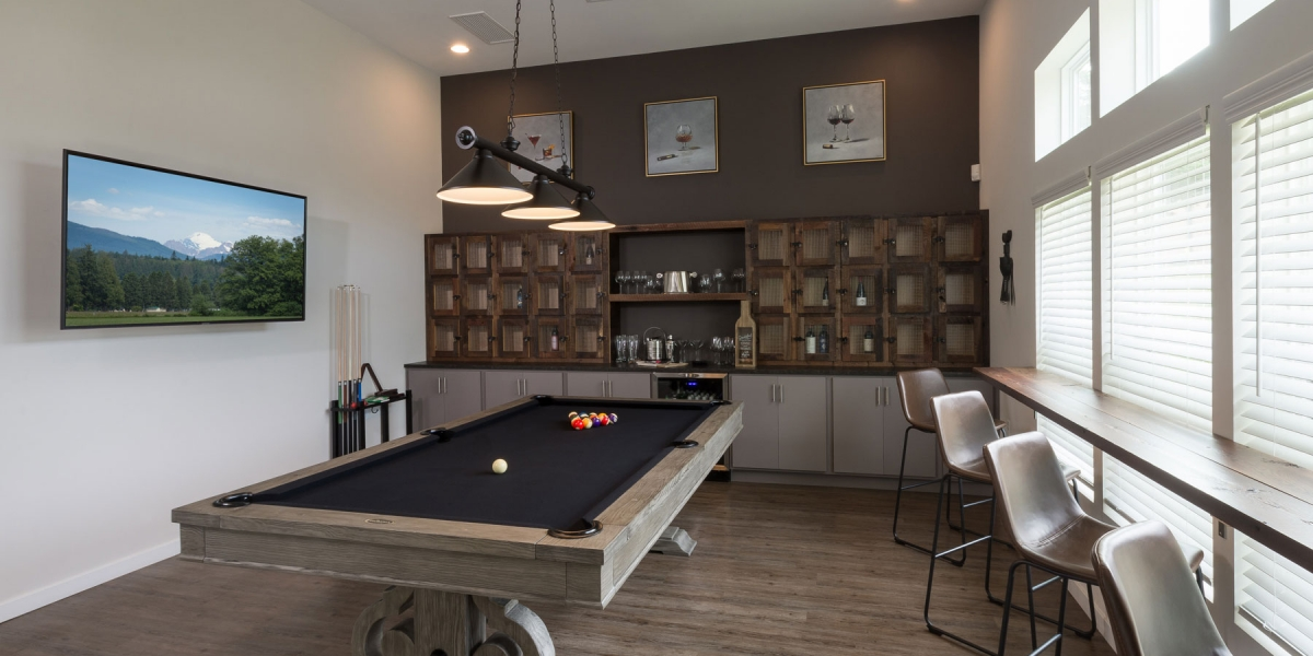 billiards room in luxury apartment clubhouse for active adults