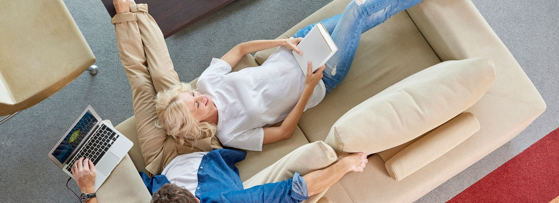 downsizing couple on couch in open floor plans retirement community